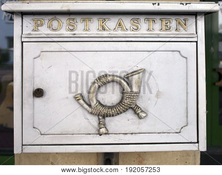 ancient mailbox Germany Close up in a sunny day