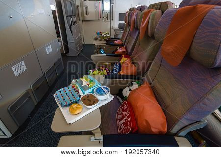 BERLIN GERMANY - JUNE 02 2016: Children's menu in the economy class of the world's largest aircraft Airbus A380. Emirates Airline. Exhibition ILA Berlin Air Show 2016