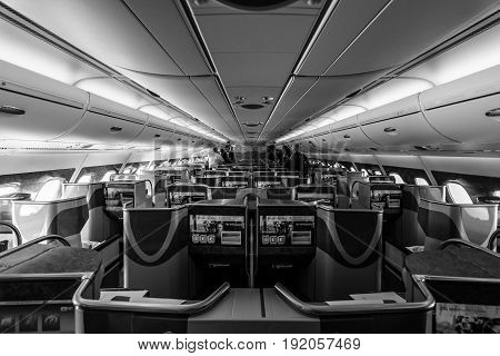BERLIN GERMANY - JUNE 02 2016: Interior of business class of the world's largest aircraft Airbus A380. Emirates Airline. Black and white. Exhibition ILA Berlin Air Show 2016