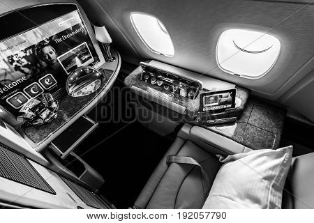 BERLIN GERMANY - JUNE 02 2016: Interior of first class of the world's largest aircraft Airbus A380. Emirates Airline. Black and white. Exhibition ILA Berlin Air Show 2016