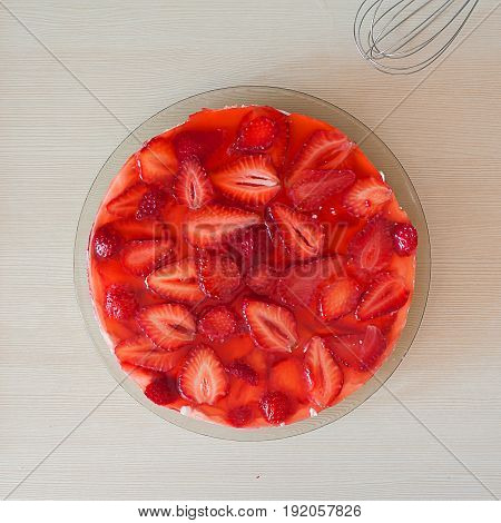 Summer homemade cheesecake with juicy strawberries view top