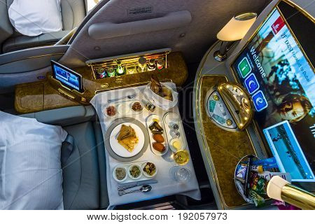 BERLIN GERMANY - JUNE 02 2016: Passenger's menu of first class of the world's largest aircraft Airbus A380. Emirates Airline. Exhibition ILA Berlin Air Show 2016