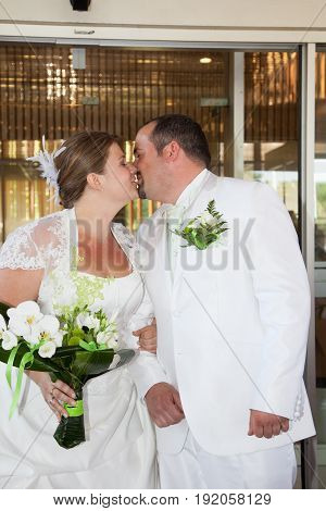 New Married Couple Kiss In Wedding Day
