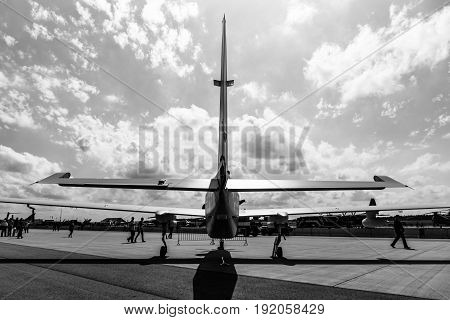 BERLIN GERMANY - JUNE 02 2016: High altitude and reconnaissance aircraft Grob G520 T. Rear view. Black and white. Exhibition ILA Berlin Air Show 2016