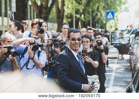 MILAN ITALY - JUNE 19: Italian journalist Giovanni Floris poses outside Armani fashion show building during Milan Men's Fashion Week on JUNE 19 2017 in Milan.