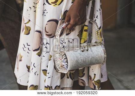 MILAN ITALY - JUNE 19: Detail of bag outside Armani fashion show building during Milan Men's Fashion Week on JUNE 19 2017 in Milan.
