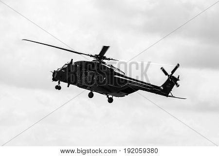 BERLIN GERMANY - JUNE 02 2016: Helicopter NH90 of the German Army. Demonstrative performance. Black and white. Exhibition ILA Berlin Air Show 2016