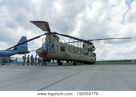 BERLIN GERMANY - JUNE 02 2016: The twin-engine tandem rotor heavy-lift helicopter Boeing CH-47 Chinook. US Army. Exhibition ILA Berlin Air Show 2016