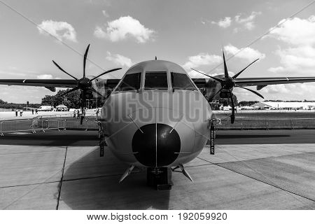 BERLIN GERMANY - JUNE 02 2016: Twin-turboprop tactical military transport aircraft EADS CASA C-295M. Polish Air Force. Black and white. Exhibition ILA Berlin Air Show 2016