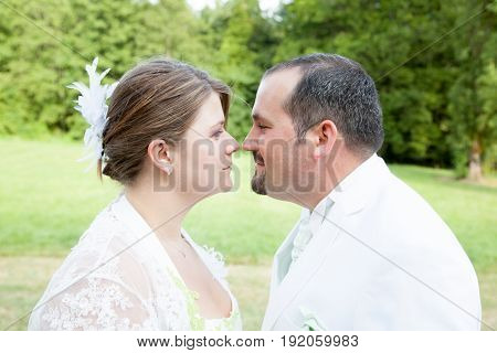 Couple In Wedding Day Playing Outdoor In Park
