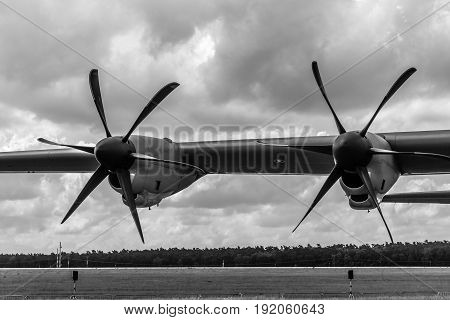 BERLIN GERMANY - JUNE 02 2016: Detail of the turboprop military transport aircraft Lockheed Martin C-130J Super Hercules. US Air Force. Black and white. Exhibition ILA Berlin Air Show 2016