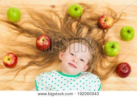 The Little Girl Among Apples