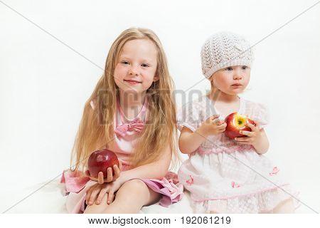 Two Little Girls Sit