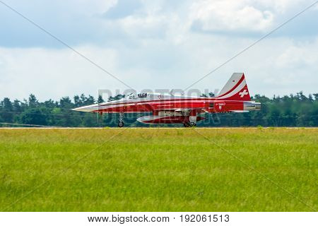BERLIN GERMANY - JUNI 02 2016: Landing of jet Northrop F-5E Tiger II. The aerobatic team Patrouille Suisse. The pilot Captain S.Billeter. Exhibition ILA Berlin Air Show 2016