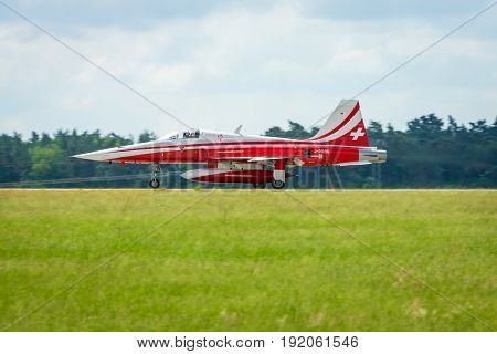 BERLIN GERMANY - JUNI 02 2016: Landing of jet Northrop F-5E Tiger II. The aerobatic team Patrouille Suisse. The pilot Captain M.Duft. Exhibition ILA Berlin Air Show 2016