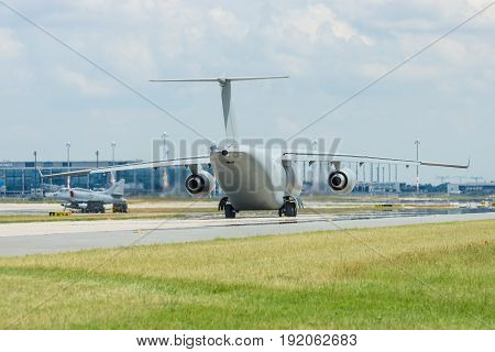 BERLIN GERMANY - JUNE 02 2016: Military transport aircraft Antonov An-178 on the taxiway. Waiting takeoff. Exhibition ILA Berlin Air Show 2016