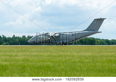 BERLIN GERMANY - JUNE 02 2016: Landing a military transport aircraft Antonov An-178. Exhibition ILA Berlin Air Show 2016