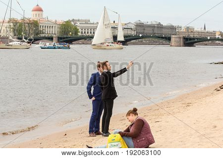 St. Petersburg Russia - 28 May, Selfies on the banks of the Neva,28 May, 2017. Famous sightseeing places of St. Petersburg for tourists.