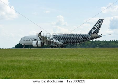BERLIN GERMANY - JUNE 02 2016: The newest Airbus A350 XWB at the airfield. Exhibition ILA Berlin Air Show 2016