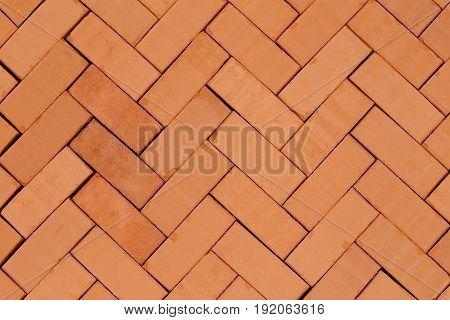 fish- bone pattern with red bricks on ground