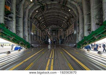 BERLIN GERMANY - JUNE 02 2016: The cargo compartment of military transport aircraft Antonov An-178. Exhibition ILA Berlin Air Show 2016