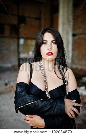 Brunette Plus Size Sexy Woman With Earring In The Nose, Wear At Black Leather Jacket, Lace  Bra At A