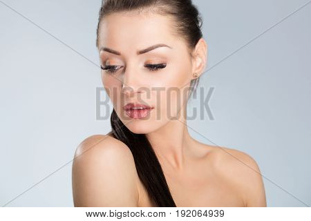 Young Sensual Woman With Black Hair Looking Down