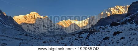 Snowy Landscape Panorama in Himalaya Mountains. Sunrise Annapurna South peak, Annapurna Base Camp Track.