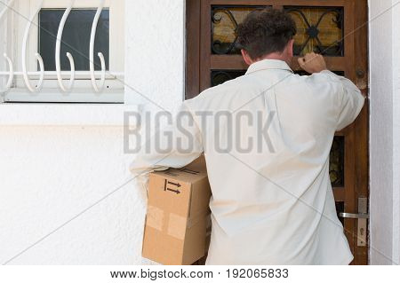 A Delivery Man Service At House Home