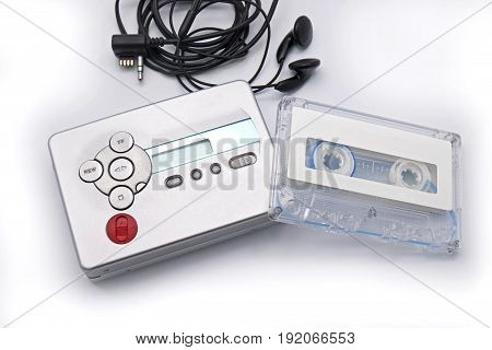 Cassette Player with Tape and Earphone on White Background