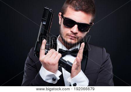 Portrait Of Handsome Killer Loading His Pistol