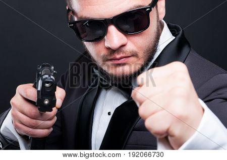 Closeup Portrait Of Violent Killer With Hand Gun