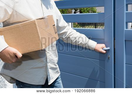 Delivery Man Arrive At Home With Order Parcel