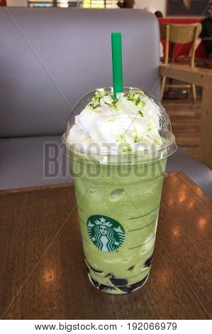 BANGKOK THAILAND 19 JUNE 2017: Glass of Starbucks Matcha earl grey jelly topping whip cream on the table in Starbucks coffee shop