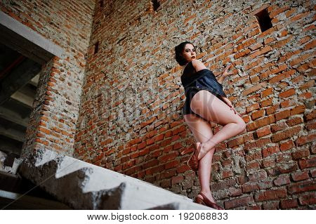 Brunette Plus Size Sexy Woman, Wear At Black One Piece And Leather Jacket, At Abadoned Place. Show H