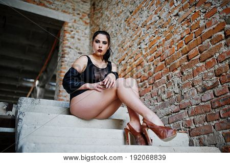Brunette Plus Size Sexy Woman, Wear At Black One Piece And Leather Jacket, At Abadoned Place Sitting