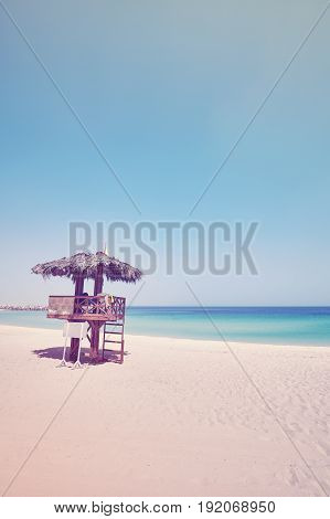 Vintage Toned Wooden Lifeguard Tower On A Tropical Beach