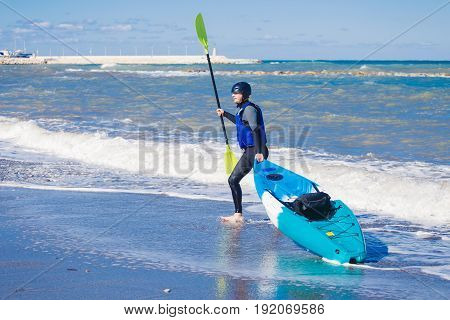 Men by sea kayaking. Traveling by kayak. Leisure activities on the water.