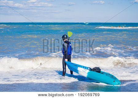 Men by sea kayaking. Traveling by kayak. Leisure activities on the water.