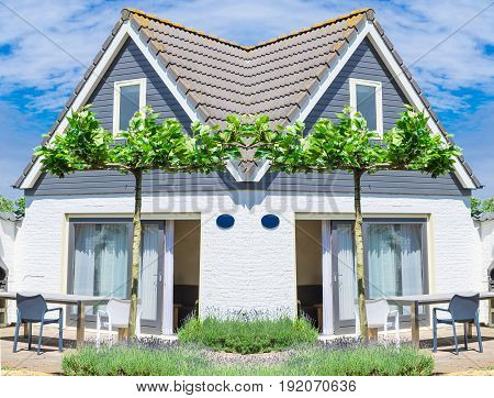 Beautiful holiday house complex with terrace in front of a blue sky
