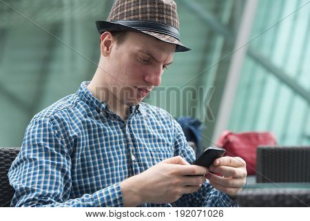 Hipster guy send message by mobile phone