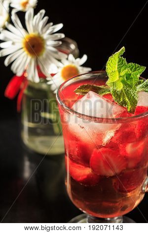 Carbonated Lemonade With Strawberry Slices And Mint With Flowers Of Chamomile