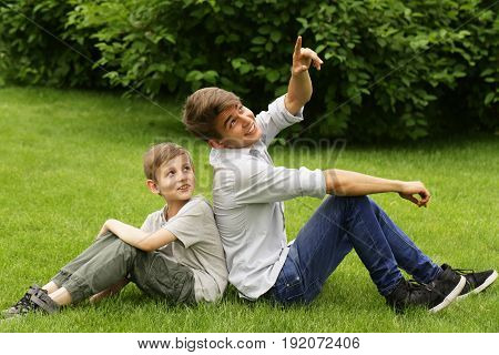 Two brothers have fun in the park - summer time, picnic