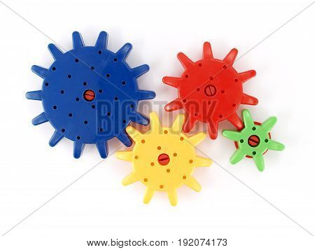 plastic gear isolated on white background, toy that looks like an engine parts for kid learning, close-up top view