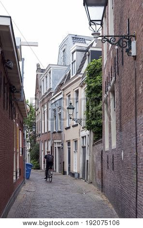 Leeuwarden Netherlands 11 june 2017: man on bicycle and old houses in the centre of old capital Leeuwarden of province of friesland in the netherlands