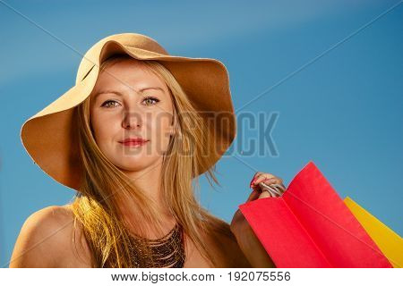 Portrait Of Elegant Woman With Shopping Bags