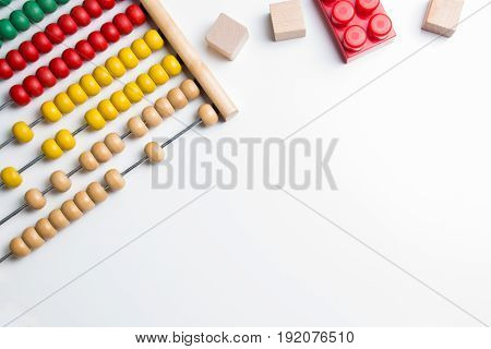 Colorful abacus and kids toy on white background