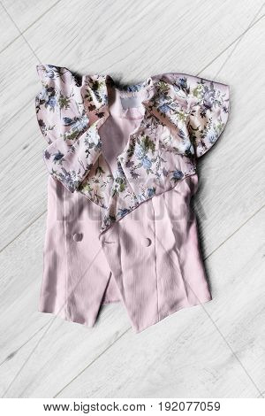 Pink silk blouse on gray wooden background