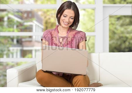 Woman laptop using home furnishings hearth and home green white