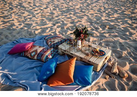 Romantic dinner candles at ocean beach. Honeymoon proposal or wedding background concept.